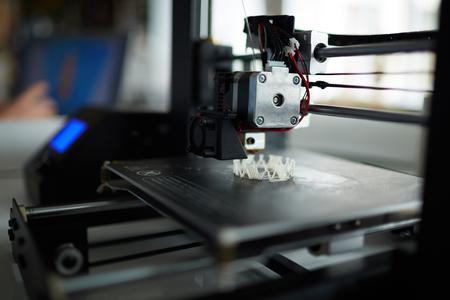 Photo pour Modern 3d printer at workplace of architect - image libre de droit