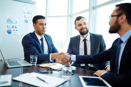 Handshaking business partners after negotiations