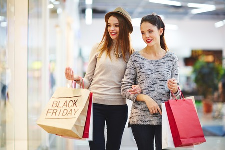 Foto de Modern customers shopping on Black Friday - Imagen libre de derechos