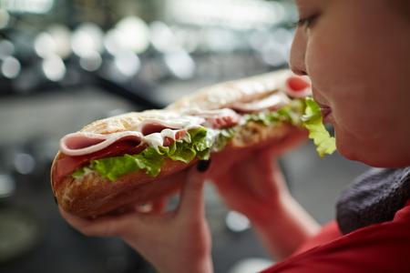 Photo pour Obese Woman Holding Unhealthy Food - image libre de droit