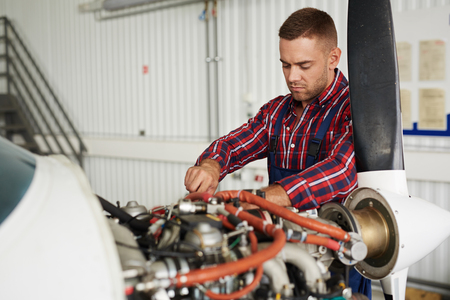 Photo for Plane Maintenance Engineer Repairing Engine - Royalty Free Image