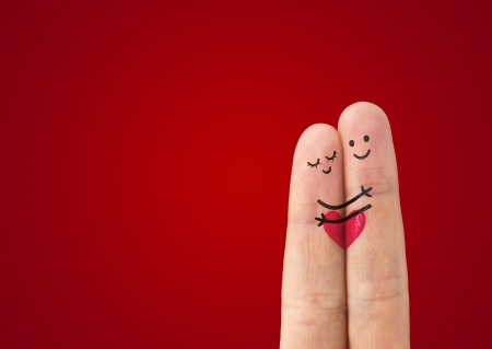 Photo for А happy couple in love with painted smiley and hugging - Royalty Free Image