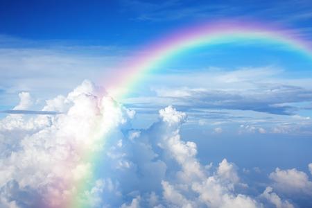 Foto de Blue sky with clouds and a rainbow - Imagen libre de derechos