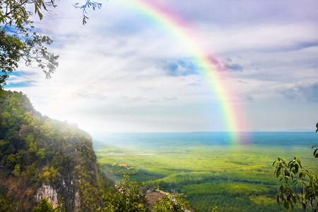 Photo pour beautiful landscape with cloudy blue sky and rainbow - image libre de droit