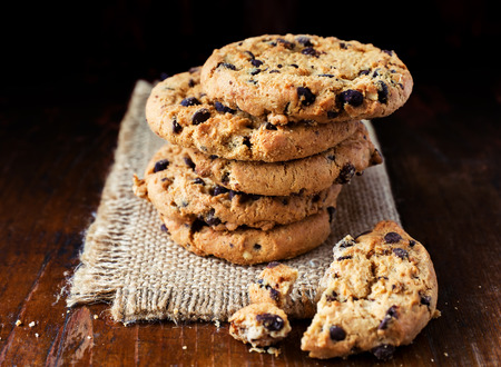 Photo for Chocolate chip cookies on old wooden table - Royalty Free Image
