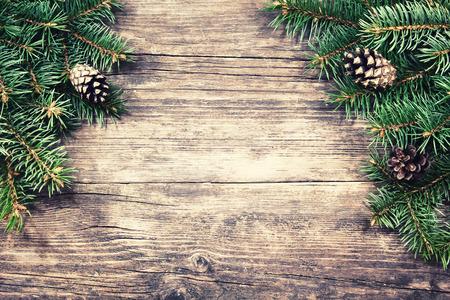 Photo pour Christmas fir tree on a wooden background, vintage style - image libre de droit