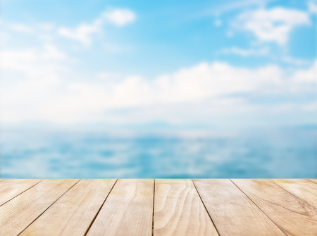 Foto de Wooden table top on blue sea and white sand beach background - Imagen libre de derechos