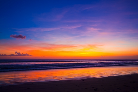 Tropical sunset on the beach. Bali island. Indonesia mural
