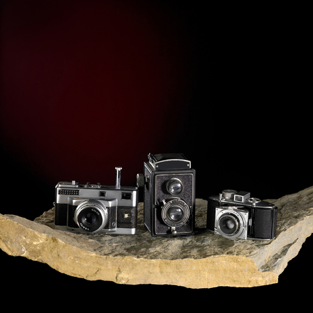 Photo pour Nostalgic cameras on stone surface in dark back - image libre de droit