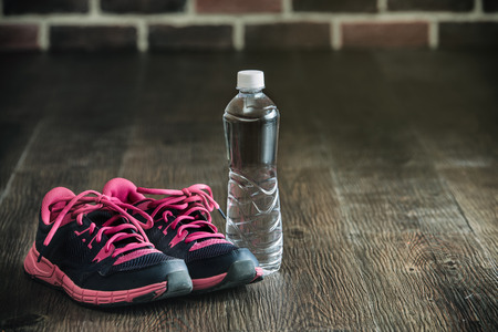 fitness running sports equipment, sneakers water on wooden floor, healthy lifestyle