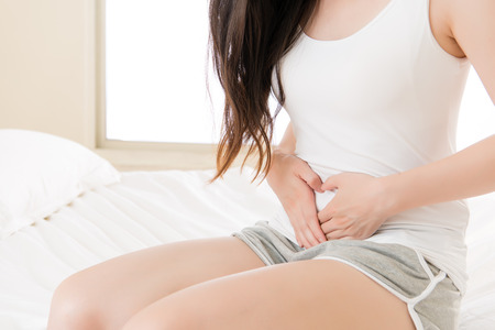 Photo for Beautiful asian woman suffering from stomach pain at home on bed, bedroom background, Physiological period concept - Royalty Free Image