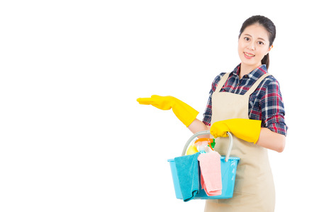 Foto de portrait of cleaning service with cleaning equipment presenting gesture isolated on white background. Beautiful fresh energetic multiracial Chinese Asian female model. - Imagen libre de derechos