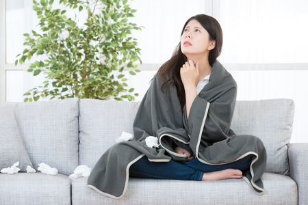 Foto de Sick Woman with Allergy reaction. Woman Caught Cold and Flu feel throat painful. medical and health concept. mixed race asian chinese model - Imagen libre de derechos