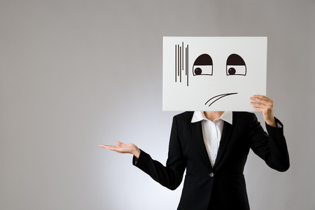 Foto de business office lady holding poster with embarrassed illustrate and promoting hand gesture. isolated on gray background. business office company concept. - Imagen libre de derechos