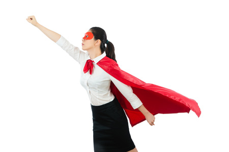 Foto de superhero business woman flying with red hero goggles cape clothing gesture fist ready take off above the white copyspace wall background over blank area concept. - Imagen libre de derechos