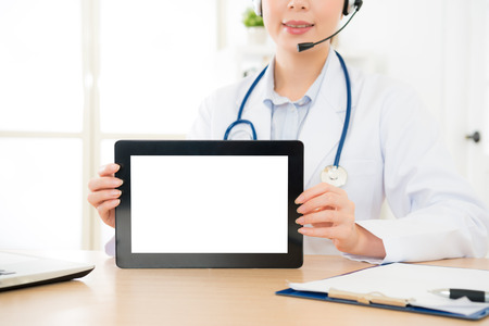 Photo for woman with microphone smiling hands holding digital tablet with empty blank screen for copyspace text message, person browsing medicine internet web or connecting to wireless touchscreen pad. - Royalty Free Image