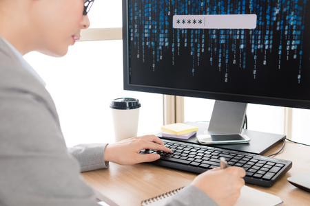 Foto de selective focus photo of pretty elegant woman manager researching online account information security system and writing record on notebook. - Imagen libre de derechos