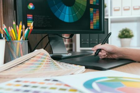 Foto de selective focus photo of graphic designer using digital pad pen work. - Imagen libre de derechos