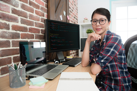 Foto für confident professional female programmer worker face to camera smiling when she sitting on workplace doing development new internet system. - Lizenzfreies Bild