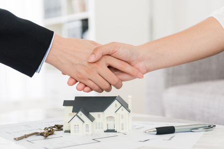 Foto de house agent successfully selling building scheme concept - business lady with investor buyer finished deal and handshake. - Imagen libre de derechos
