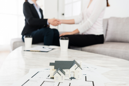 Photo pour house adviser successfully selling building case with her buyer finished deal handshake together. selective focus photo. - image libre de droit