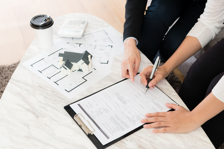 Photo pour high angle view photo of buyer decision to buying new house and signing contract document finished deal at home with agent manager woman. - image libre de droit