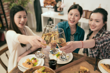 Photo pour Friends hands toasting champagne glass and having fun cheering - Young people enjoying harvest time together at home party - Youth and friendship concept - image libre de droit