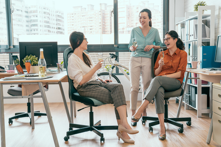 Photo for Successful team celebrates concept. Group of cheerful young people discussing something with smile while sitting or standing in office - Royalty Free Image