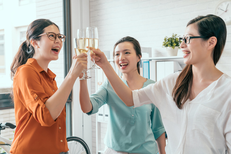 Photo for Group of happy business asia team toasting with champagne in the office - Royalty Free Image
