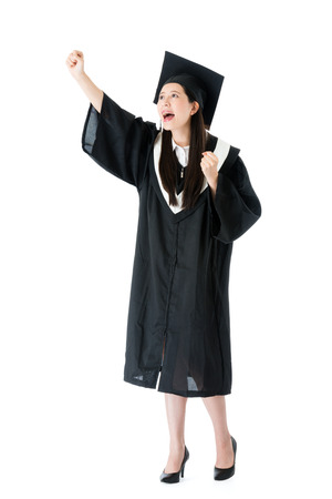 Foto de beauty cheerful female student getting graduation and making successful gesture ready to work in future isolated on white background. - Imagen libre de derechos