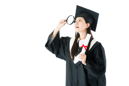 Foto de beauty elegant college student woman finished studying getting diploma and wearing graduation clothing using magnifier searching future job isolated on white background. - Imagen libre de derechos