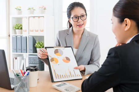 Photo pour young attractive woman manager introducing company marketing analysis report document for her cooperation case partner in order to get client trust. - image libre de droit