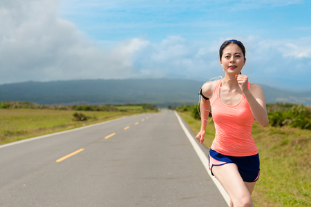 Foto de happy beautiful woman jogger running on road - Imagen libre de derechos
