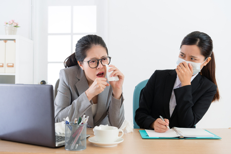 Photo pour young pretty business woman wearing medical mask feeling fear when office worker manager sickness and coughing during meeting time. - image libre de droit
