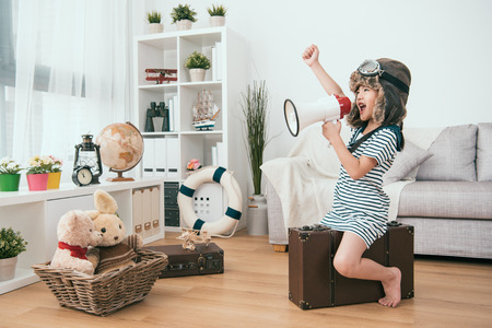 Photo for kid holding a megaphone and raising a hand. she's ready for the next round - Royalty Free Image
