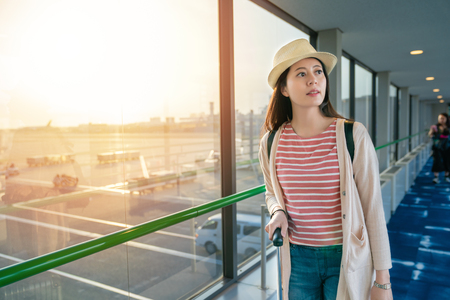 Photo pour pretty female standing next to large windows. view in airport. - image libre de droit