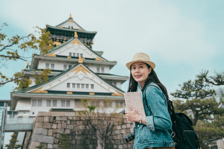 Foto de portrait of attractive Japanese tourist woman visiting japan old town and face camera with smiling. - Imagen libre de derechos