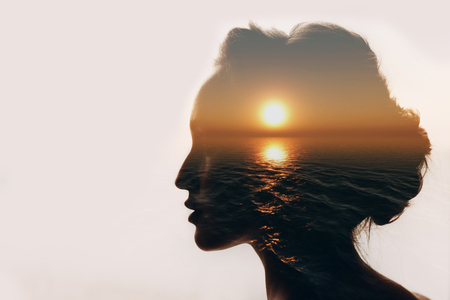 Foto de Psychology concept. Sunrise and woman silhouette. - Imagen libre de derechos