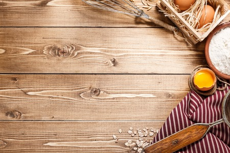 Photo pour Ingredients for baking on empty light wooden background  - image libre de droit