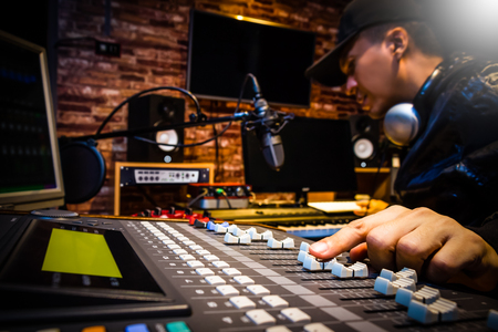 Photo for music producer working on sound mixer in recording studio or DJ working in broadcasting studio - Royalty Free Image