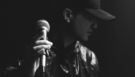 Photo for asian male singer hands on microphone, black and white - Royalty Free Image
