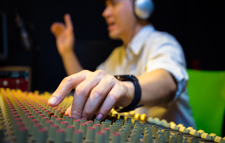 Photo pour sound engineer hands working on audio mixing console in recording, broadcasting studio - image libre de droit