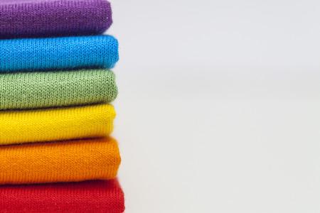 Photo pour A stack of colourful shirts  - image libre de droit