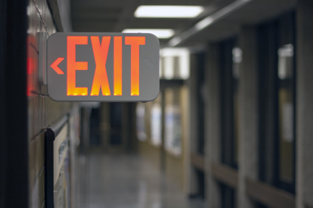 Photo for Exit Sign in Hallway - Royalty Free Image