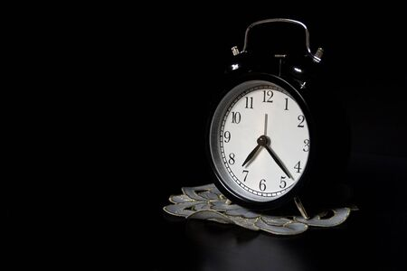 Photo for Classic mechanical alarm clock on dark background. Low key - Royalty Free Image