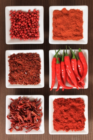 Spices in white ceramic bowls. Food and cuisine ingredients. Colorful natural additives.