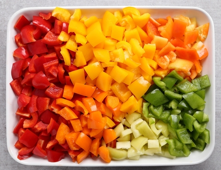 Photo for Colorful, chopped peppers in a ceramic dish. - Royalty Free Image