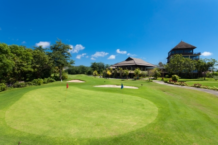 Photo for Green and holes in front of Golf clubhouse in Bali, Indonesia - Royalty Free Image