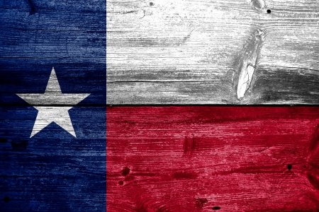 Photo for Texas State Flag painted on old wood plank texture - Royalty Free Image