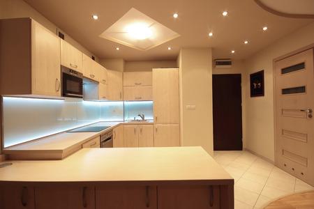 Photo pour Modern luxury kitchen with white LED lighting - image libre de droit